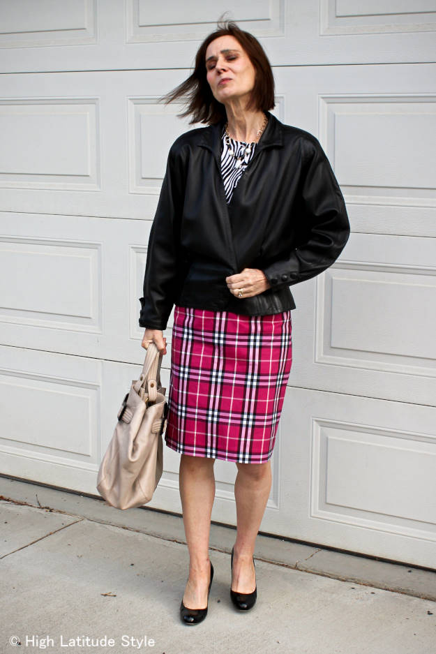style blogger in zebra print top with tartan skirt in one outfit
