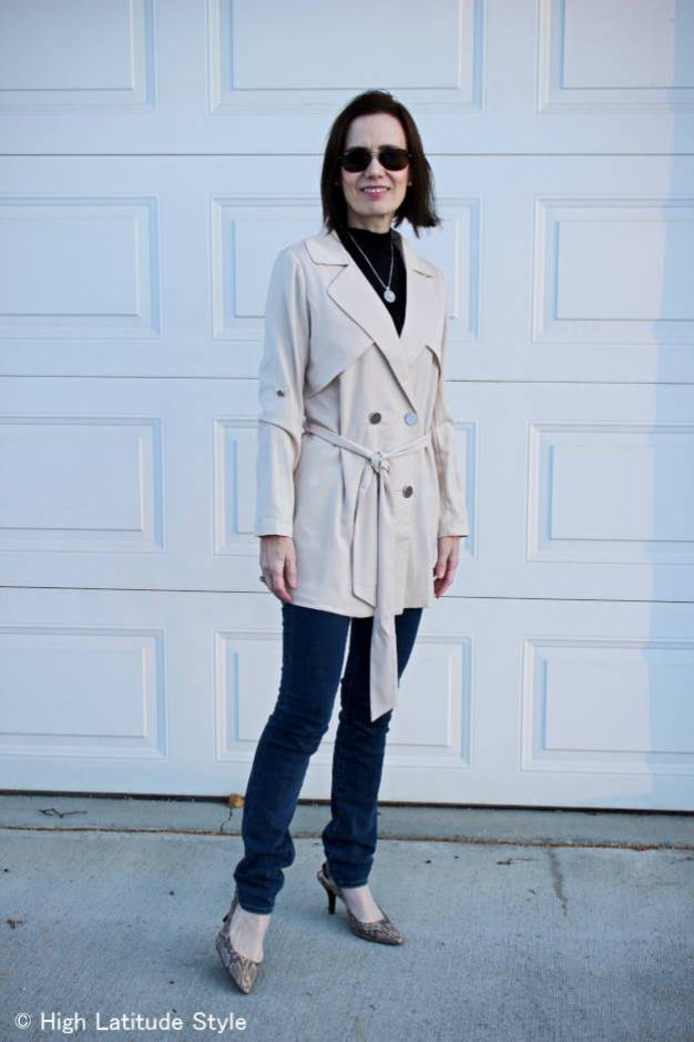 fashion blogger over 50 in trench coat with skinnies