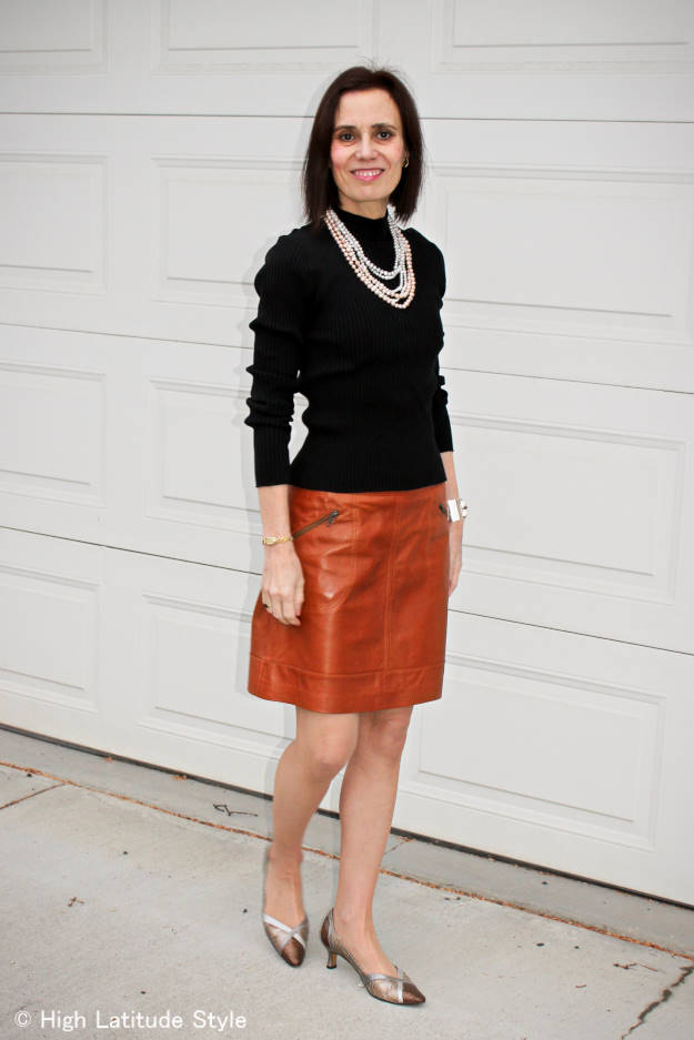 mature woman with A-line leather skirt styled for work