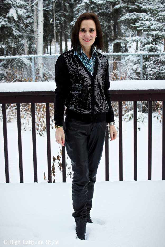 #fashionover50 winter outfit with leather pants, sequin cardigan and plaid shirt layering