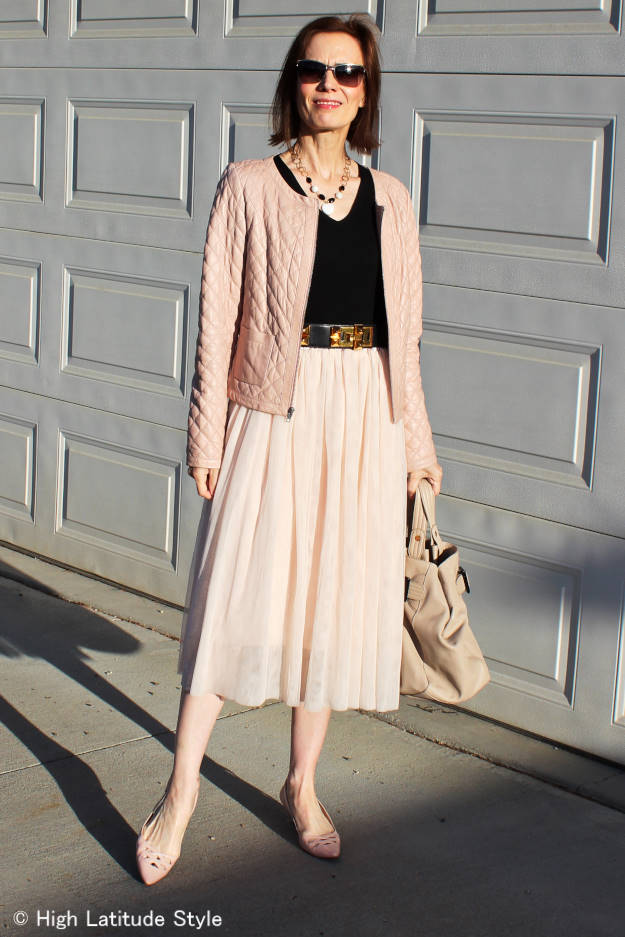 fashion blogger over 50 in blush quilted leather jacket and other desaturated colors top and bottom