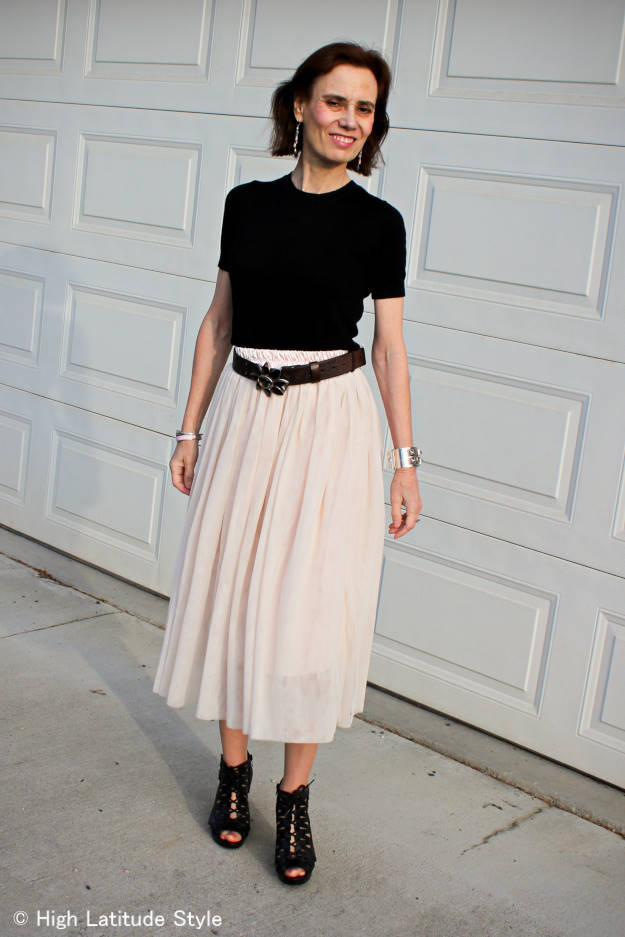 #streetstyleover50 blogger Nicole is street style lace-up booties black sweater and layered mesh-skirt