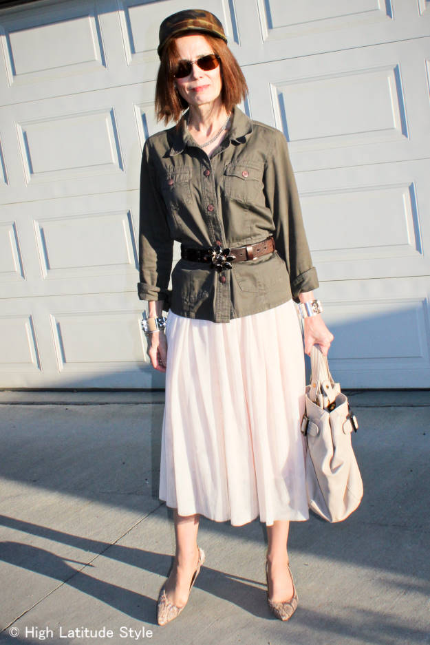 #matureStreetstyle woman in layered mesh skirt and utility jacket