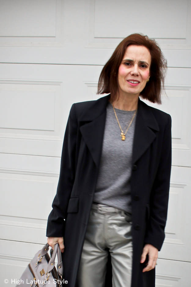 #fashionover50 older woman in trendy silver pants and all gray outfit