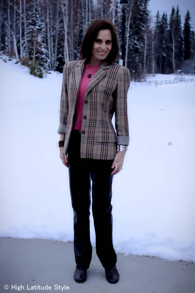 fashion blogger in unmatched suit of plaid blazer and pants