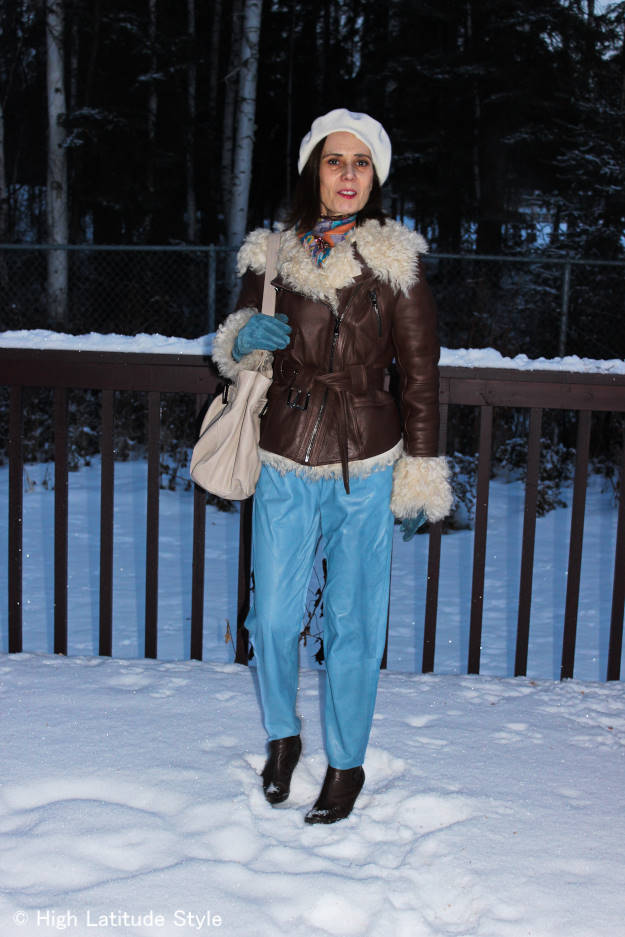 style blogger in  shearling motorcycle jacket with winter accessories and bf jeans