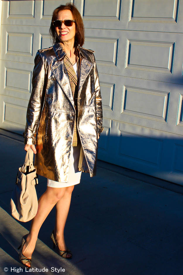 mature woman in gold leather trench coat