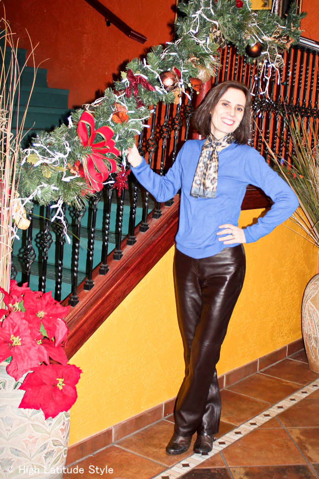 mature stylish woman with leather pants, sweater, leopard print scarf winter business casual look