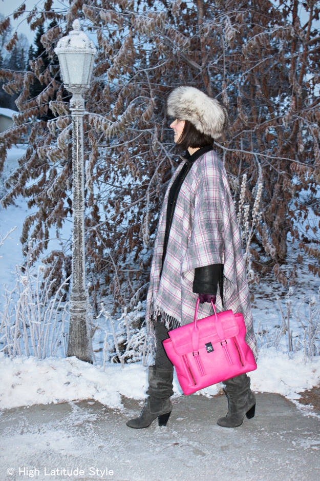 style blogger with gray, white pink plaid blanket scarf over a coat