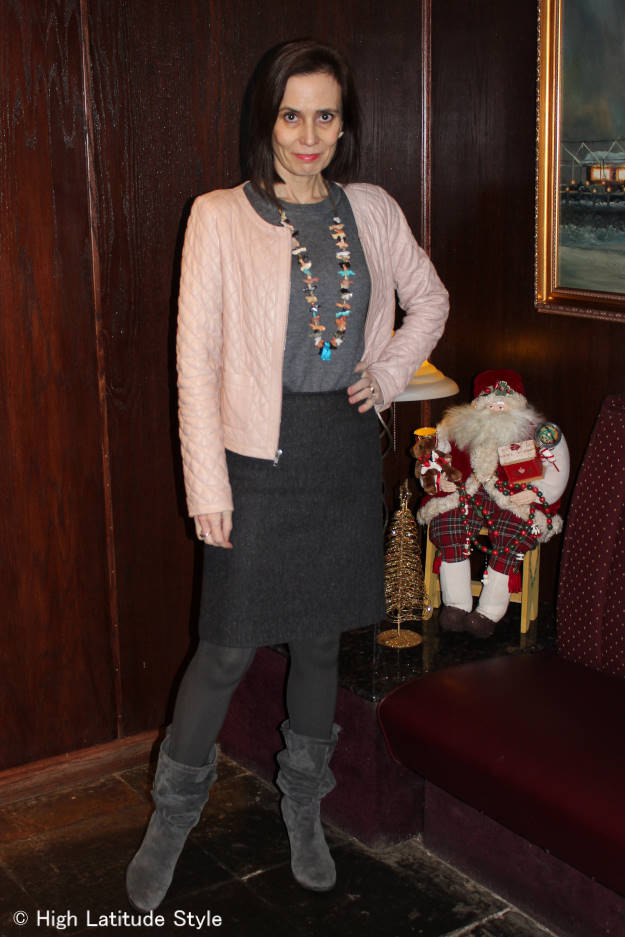 #fashionover40 Woman in winter neutral color work outfit sitting on a coach