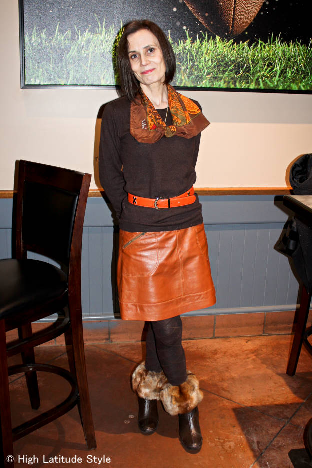 #styleover40 Alaskan woman wearing a leather skirt, tights, sweater and scarf escaping the cold of Interior Alaska