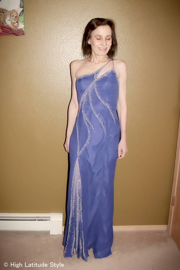 mature woman in royal blue beaded evening gown