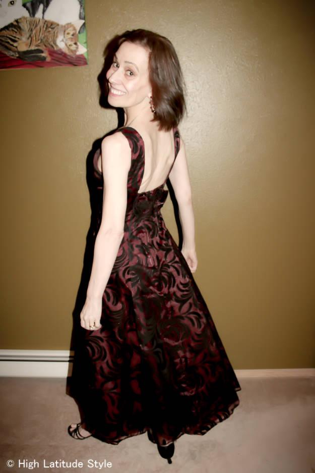 #styleover40 woman in burned velvet burgundy and black tea-length formal gown
