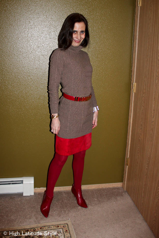 fashion blogger in cable knit dress worn over a skirt
