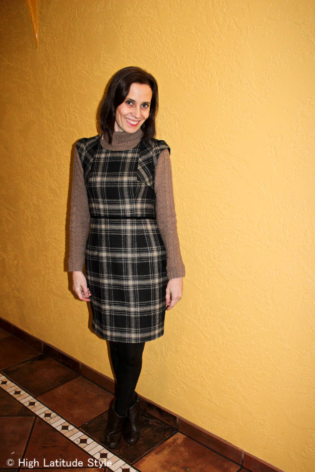 mature lady layering a dress over dress in same shade