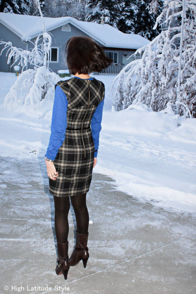 fashion blogger over 50 in plaid sheath dress