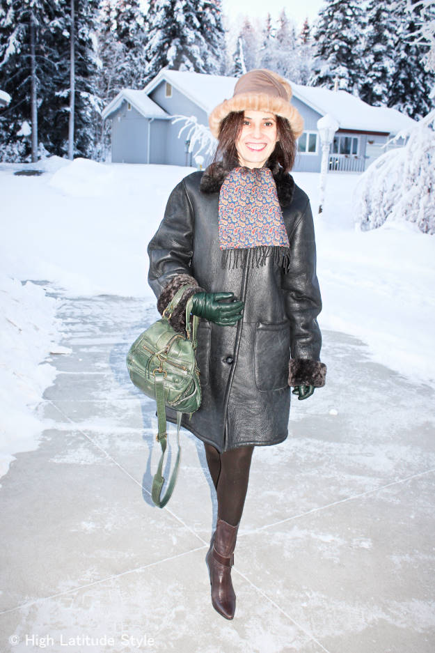 style blogger in winter work appropriate outerwear with gloves and stylish hat