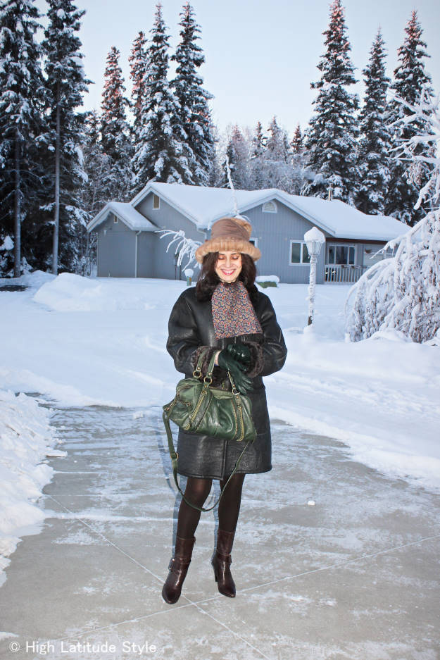 fashion blogger in winter outfit asccessorized with a Russian scraf