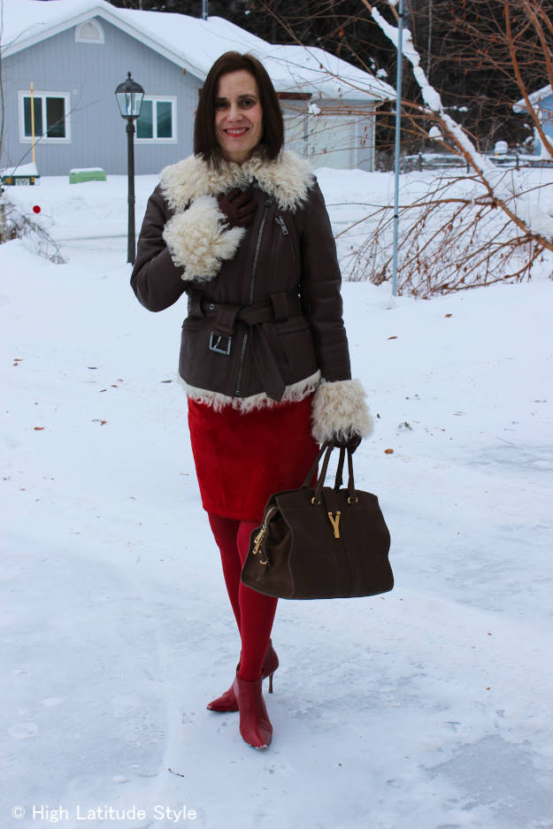 #midlifefashion style blogger Nicole donning winter outerwear in front of a frozen landscape
