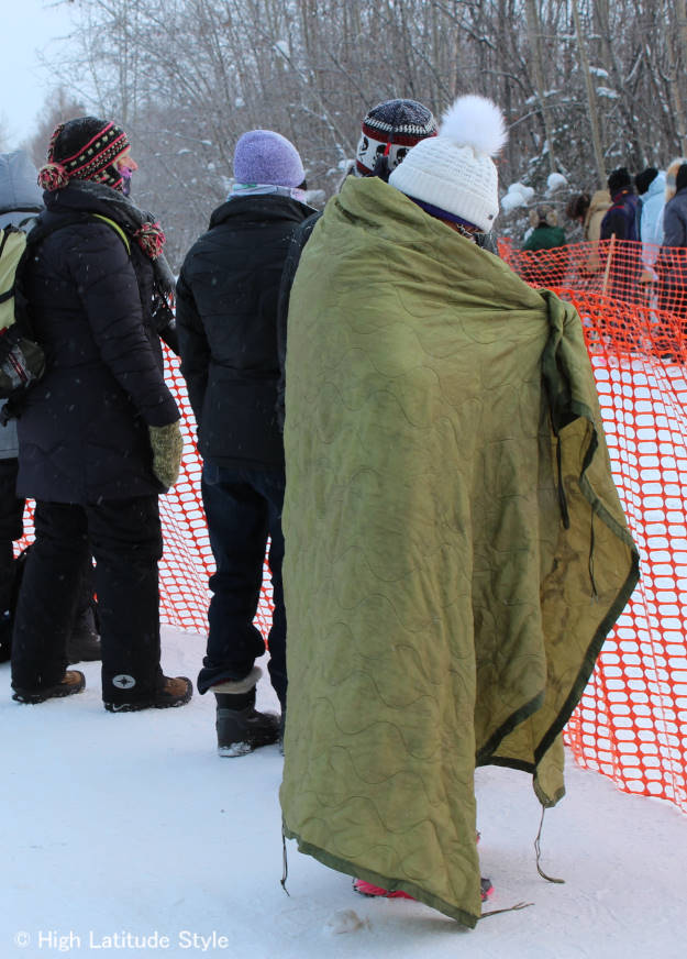 #Alaska #streetstyle women wearing a down blanket at the start of a dog race