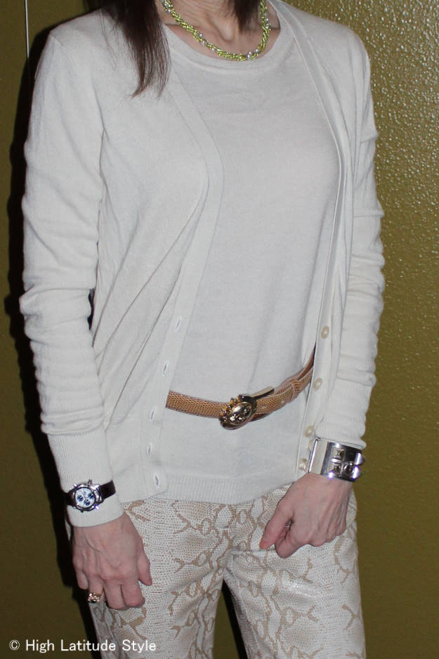 midlife blogger wearing a winter outfit in shades of cream