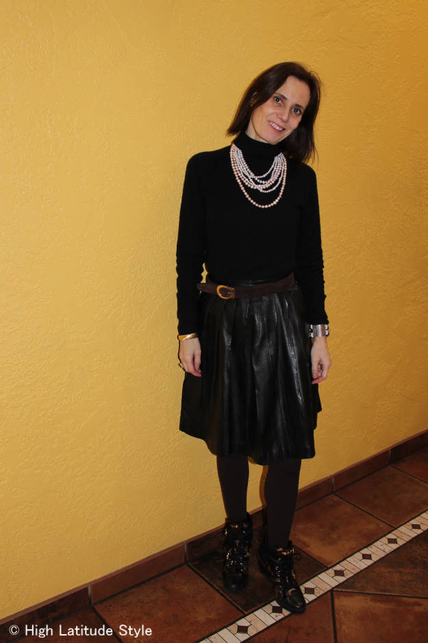 midlife blogger looking posh in a full leather skirt with wedge heels