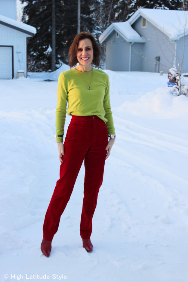 #fashionover50 woman in chartreuse sweater and red pants