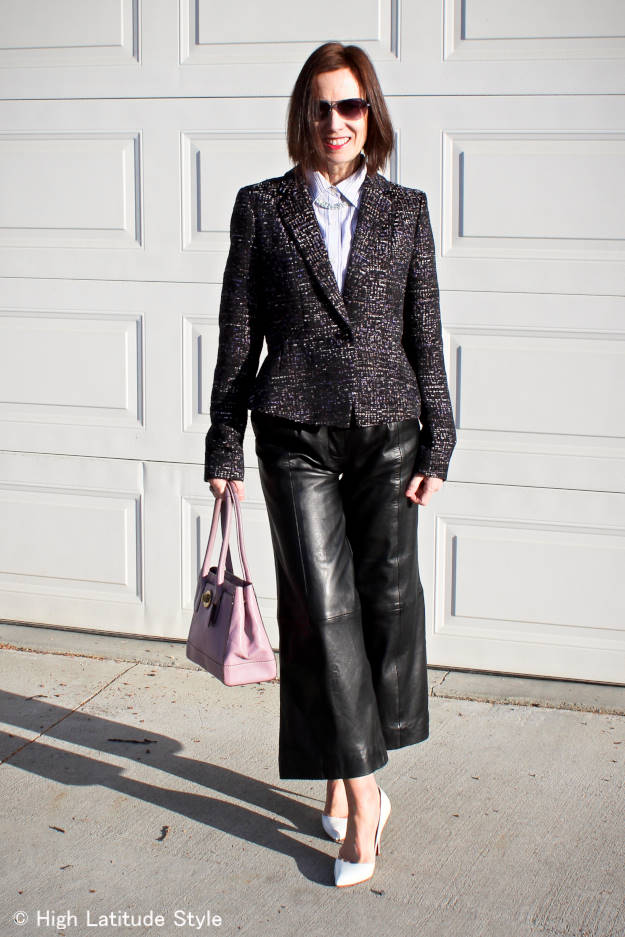 stylist in a tweed blazer with leather culottes