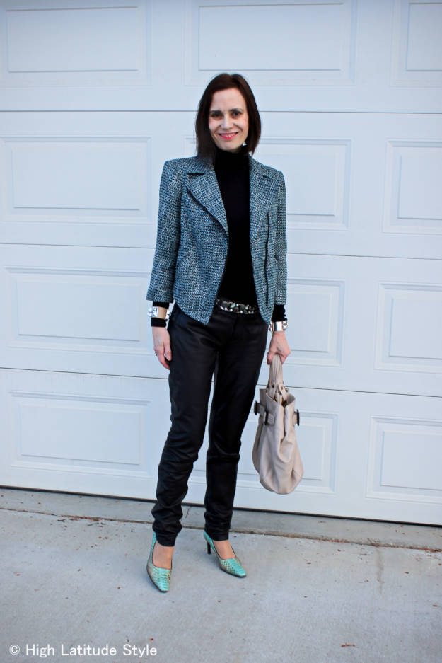 fashion over 50 midlife woman in tweed motorcycle jacket with leather pants
