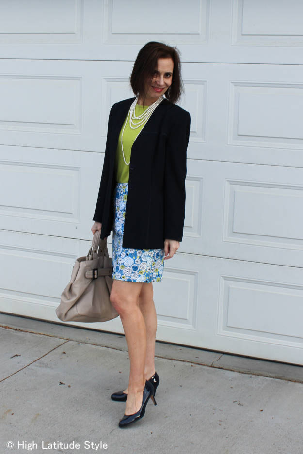 #over50fashion mature woman in floral printed skirt, chartreuse sweater with blazer work outfit
