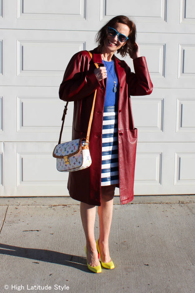 #fashionafter40 mature style blogger in a blue and white striped skirt and long burgundy leather jacket