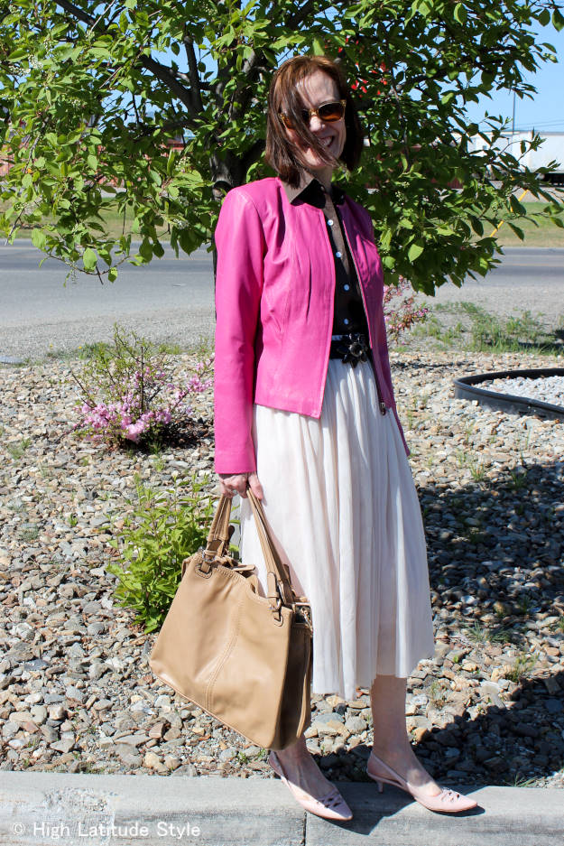 #fashionover50 woman in blush mesh skirt with pink motorcycle jacket