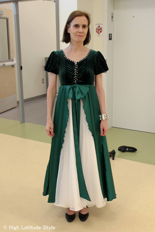 Disney ballroom dance dress in green velvet with Swaroski crystals along the neck and front, green satin over-skirt and bow, and multi-layer white chiffon