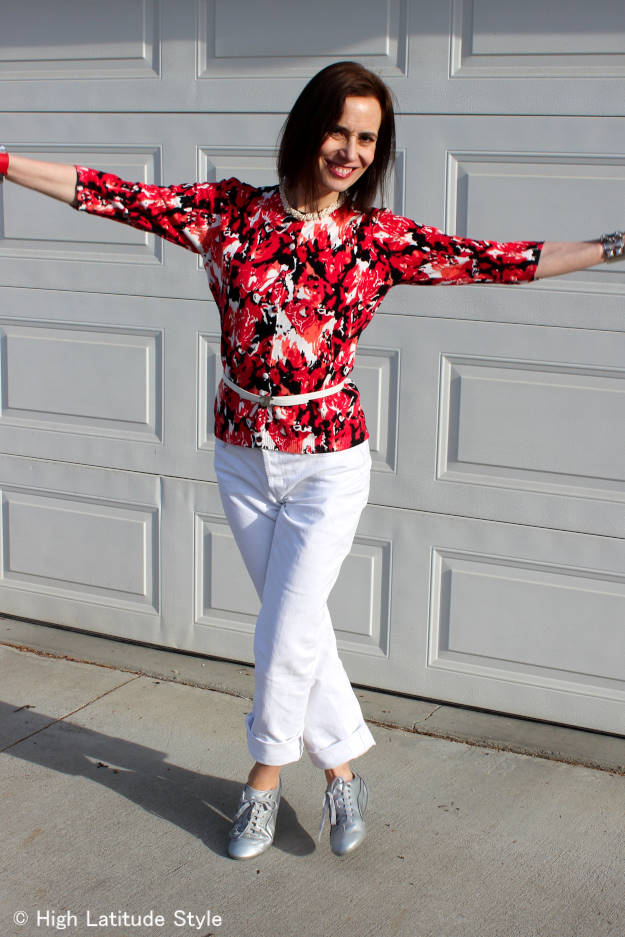 older woman in ageless blossom top with white jeans