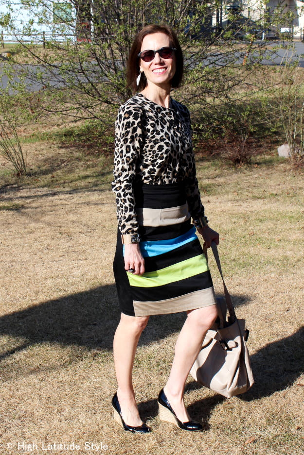 stylist in leopard print cardigan and striped skirt