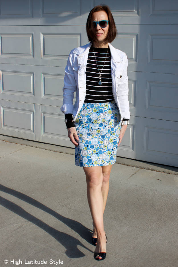 #over40fashion mature woman in floral print skirt with stripped top and white denim jacket
