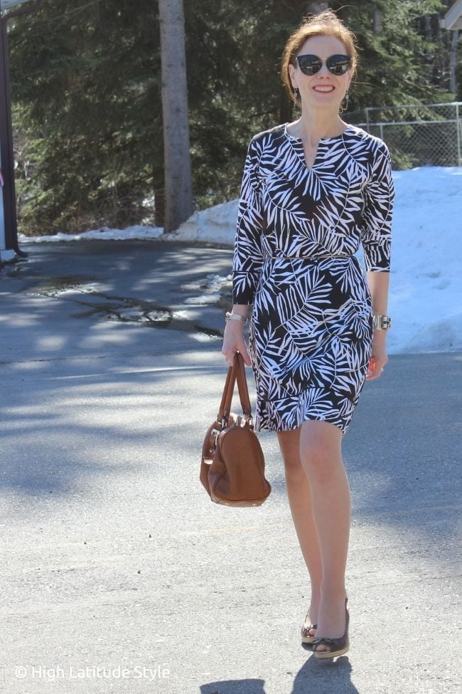 floral inspired dress pantyhose, brown bag and sandals