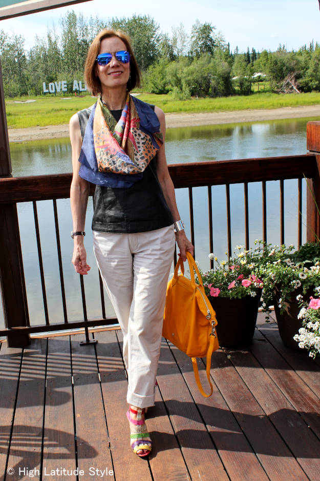 mature blogger looking chic casual in a summer outfit with leather shell width=