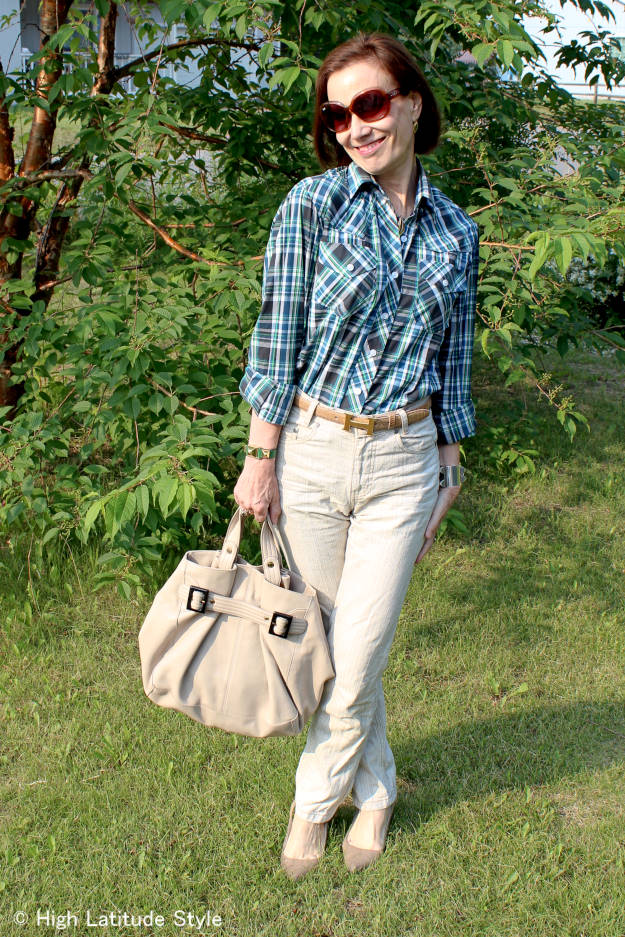 midlife fashion blogger in plaid shirt with linen pants for a casual work outfit