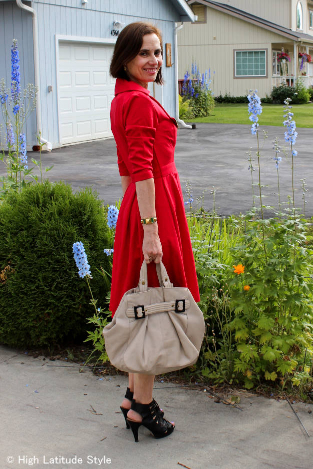 stylish woman over 50 in red dress for work