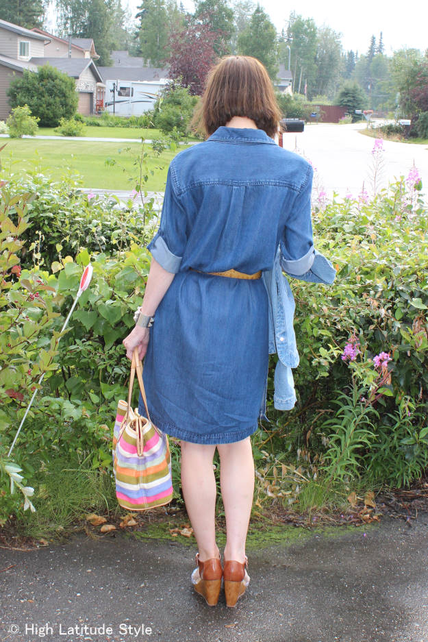 mature woman in chic denim shirt dress