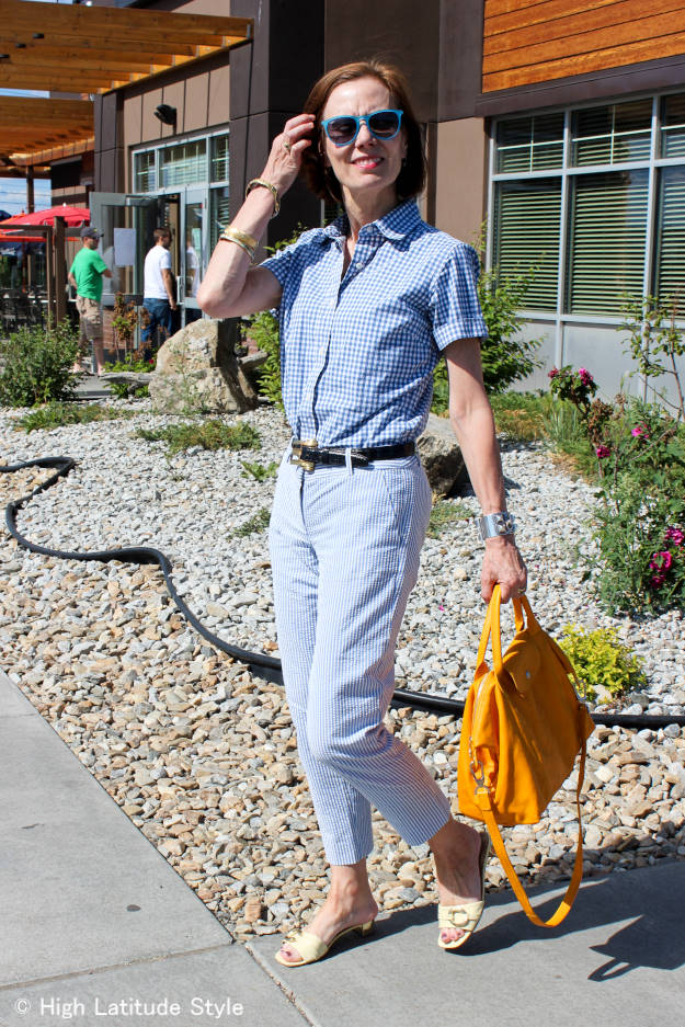 #midlifestyle woman in menswear seersucker pants and gingham button-down shirt
