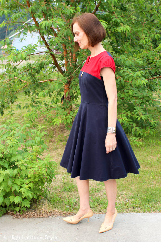 style book author donning ageless style in a fit-and-flare knit dress