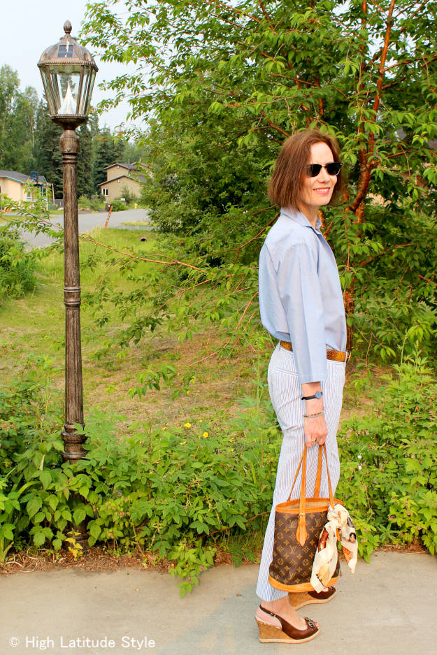 #fashionover40 #fashionover50 women in seersucker with men's shirt for a posh casual menswear inspired summer work outfit