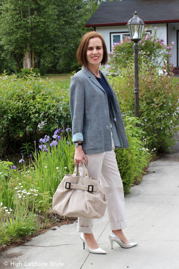 blogger Nicole wearing a casual office outfit with blazer and chinos