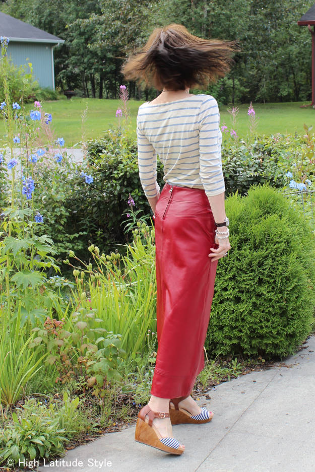 fashion blogger donning a pre-fall OOTD with long leather skirt and sleek top