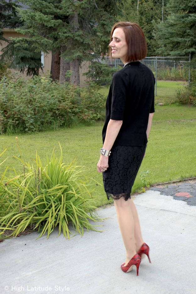 mature woman in black separates