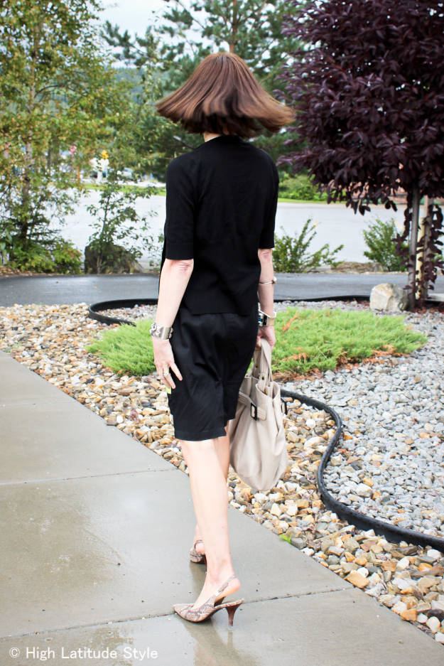 woman in short sleeve cardigan with skirt