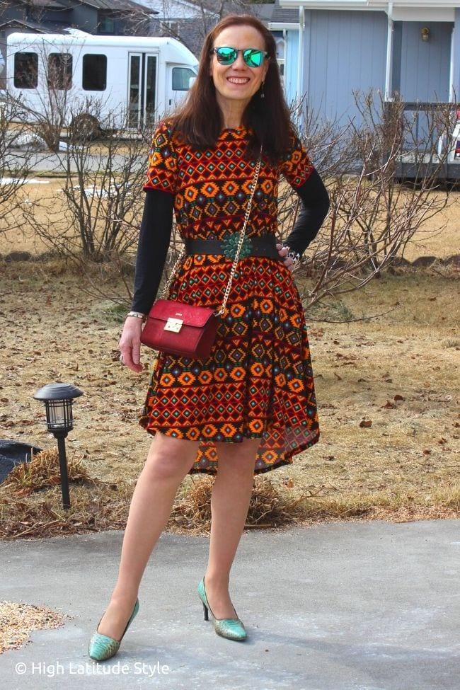 ikat print dress with high low hem, pumps, belt, sunnies