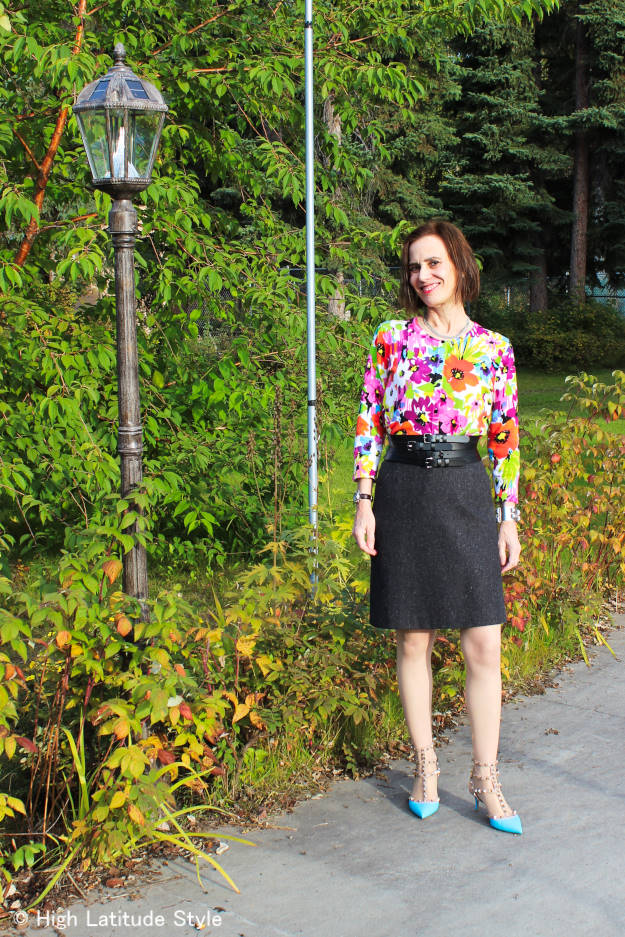 style book author in a tweed skirt with floral top